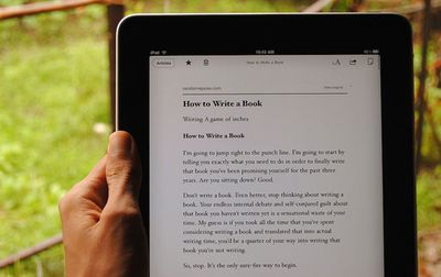 A person reads an article on an iPad