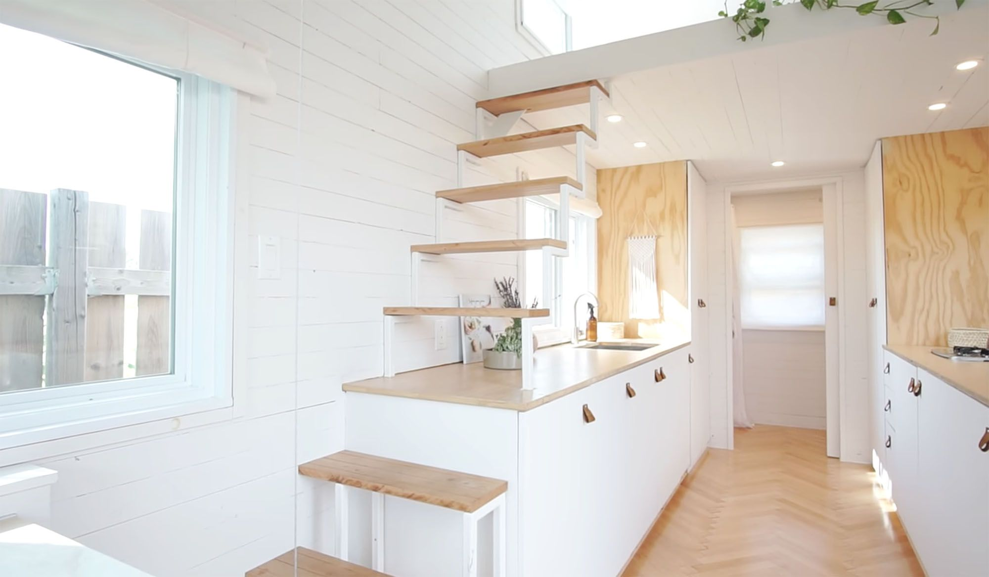 family of three diy tiny house transformer furniture open staircase
