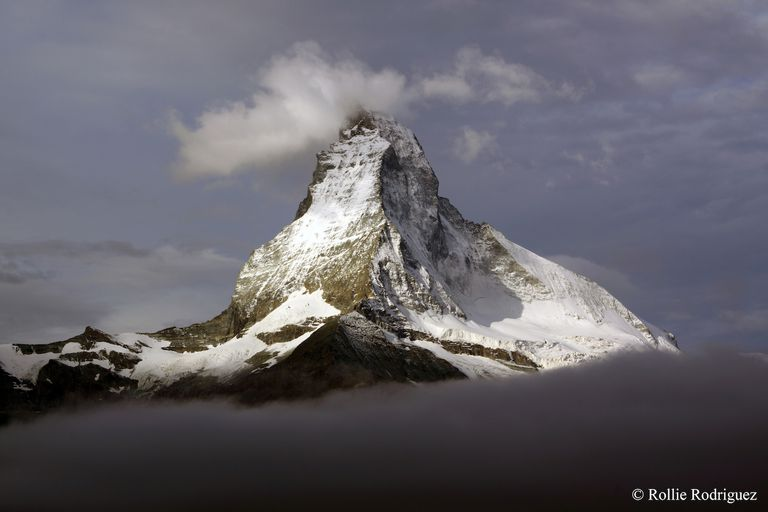Snowy mountain peak among the clouds