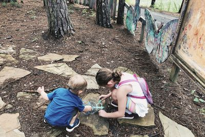 kids drawing with chalk in an outdoor classroom