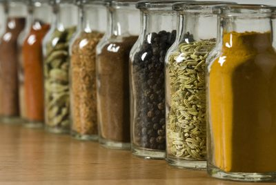 Row of glass containers with food