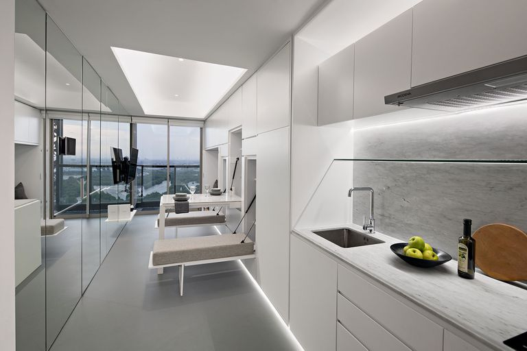 3 in 1 Apartment by K-Thengono Design Studio interior with dining area out
