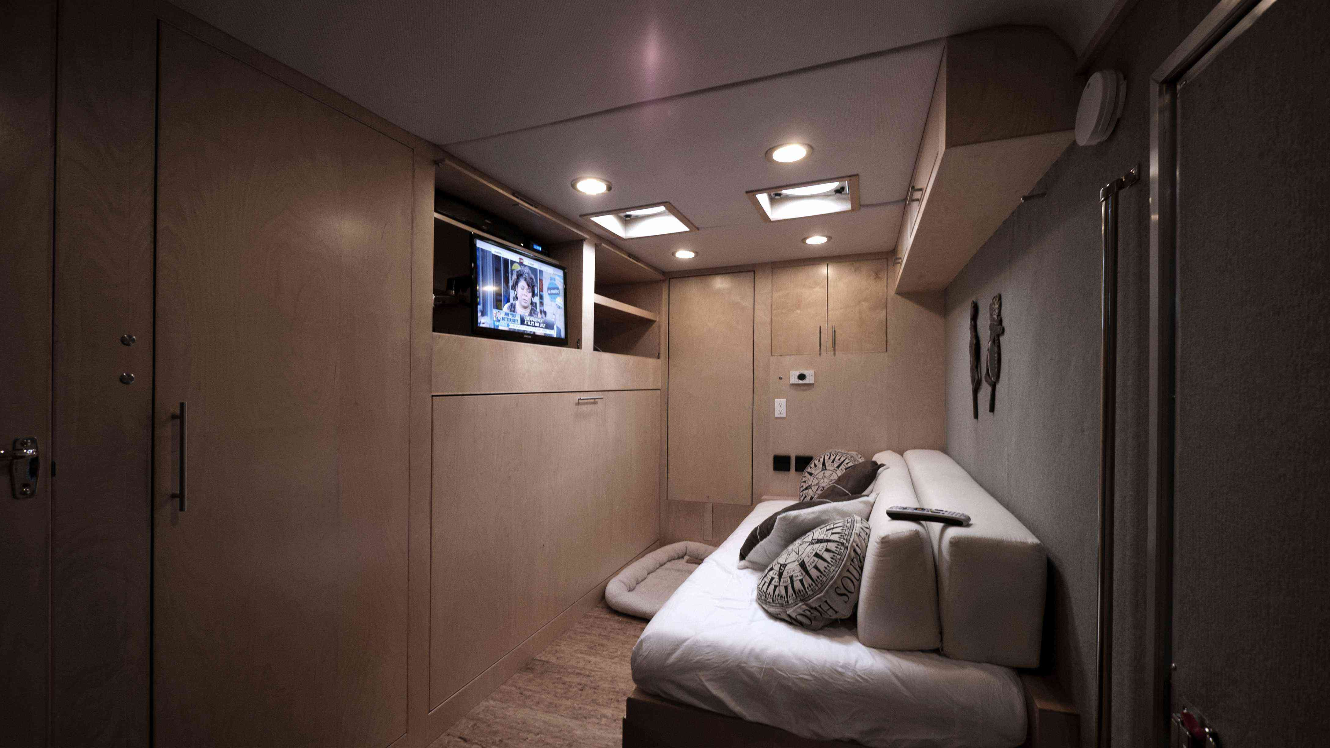 White couch in the beige interior of a trailer