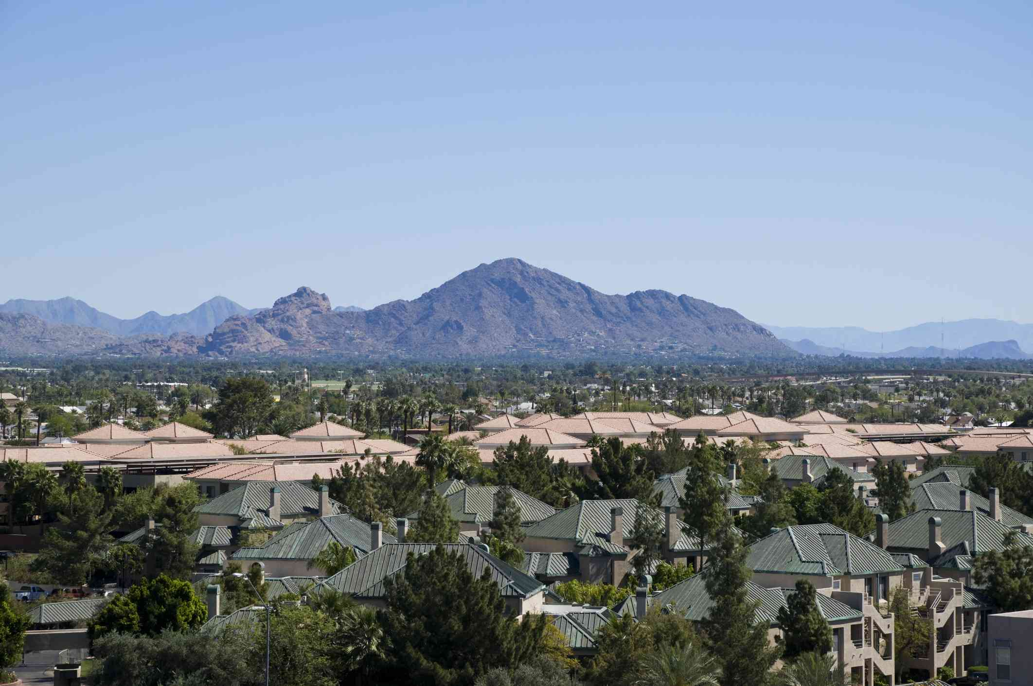 Aerial view of Camelback Mountain with a clear blue sky above and the city of Phoenix, Arizona in the foreground