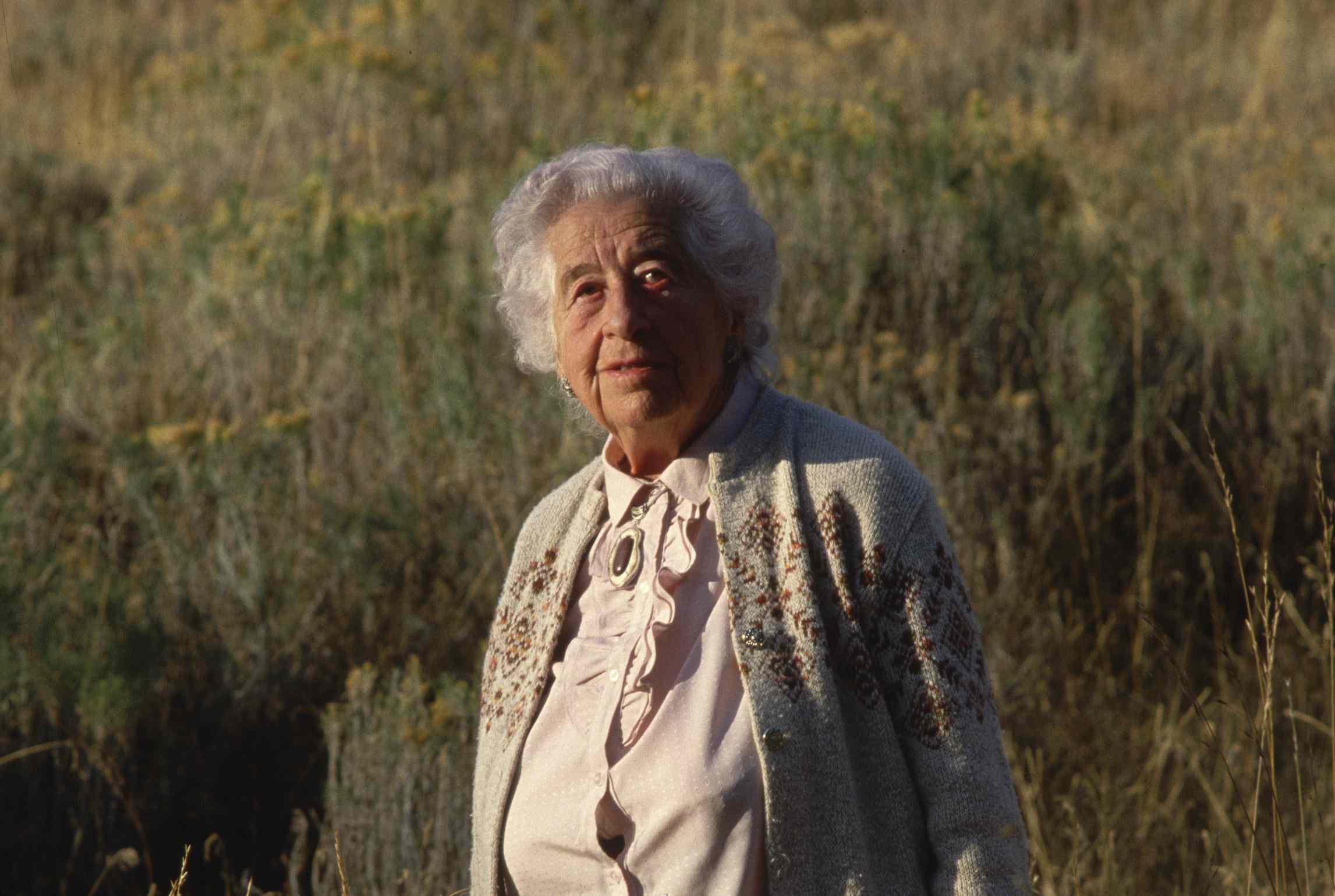 Portrait of Margaret Murie in a meadow