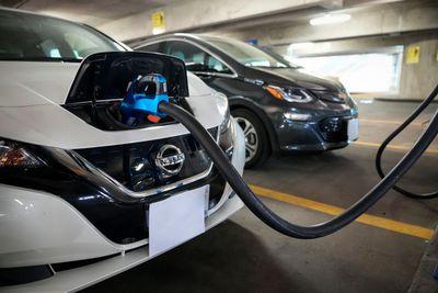 Nissan Leaf charging in a parking garage.