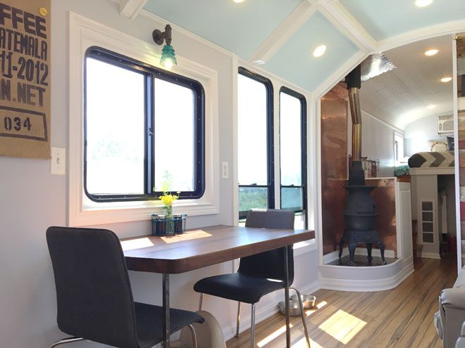 Seating area in school bus converted tiny house