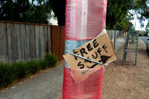 'free stuff' sign attached to a post