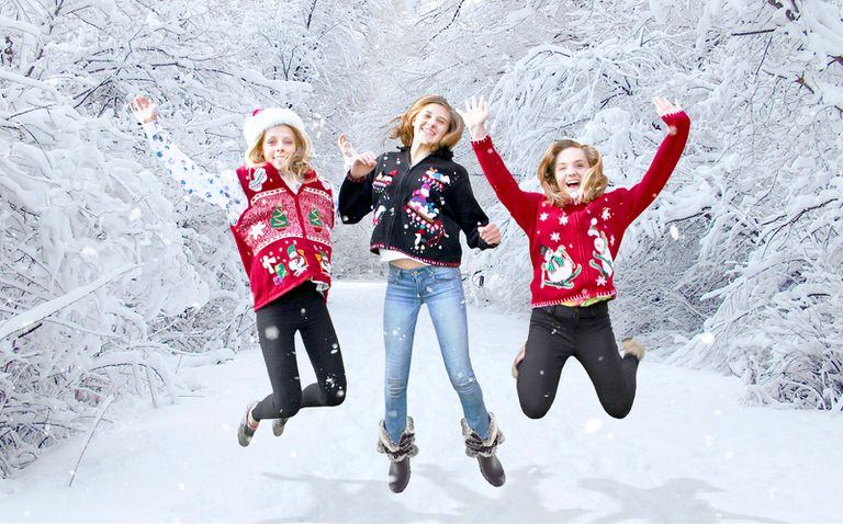 girls jumping in ugly sweaters
