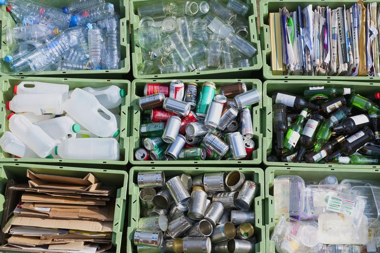 Recycling sorted into several bins by category