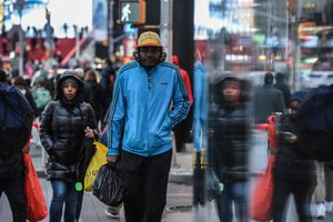 people on sidewalk bundled up against the cold weather