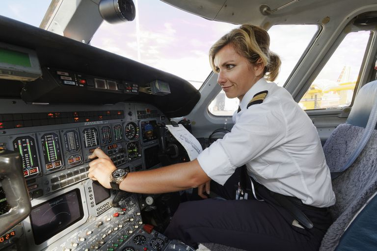 Female pilot in commercial aircraft cockpit