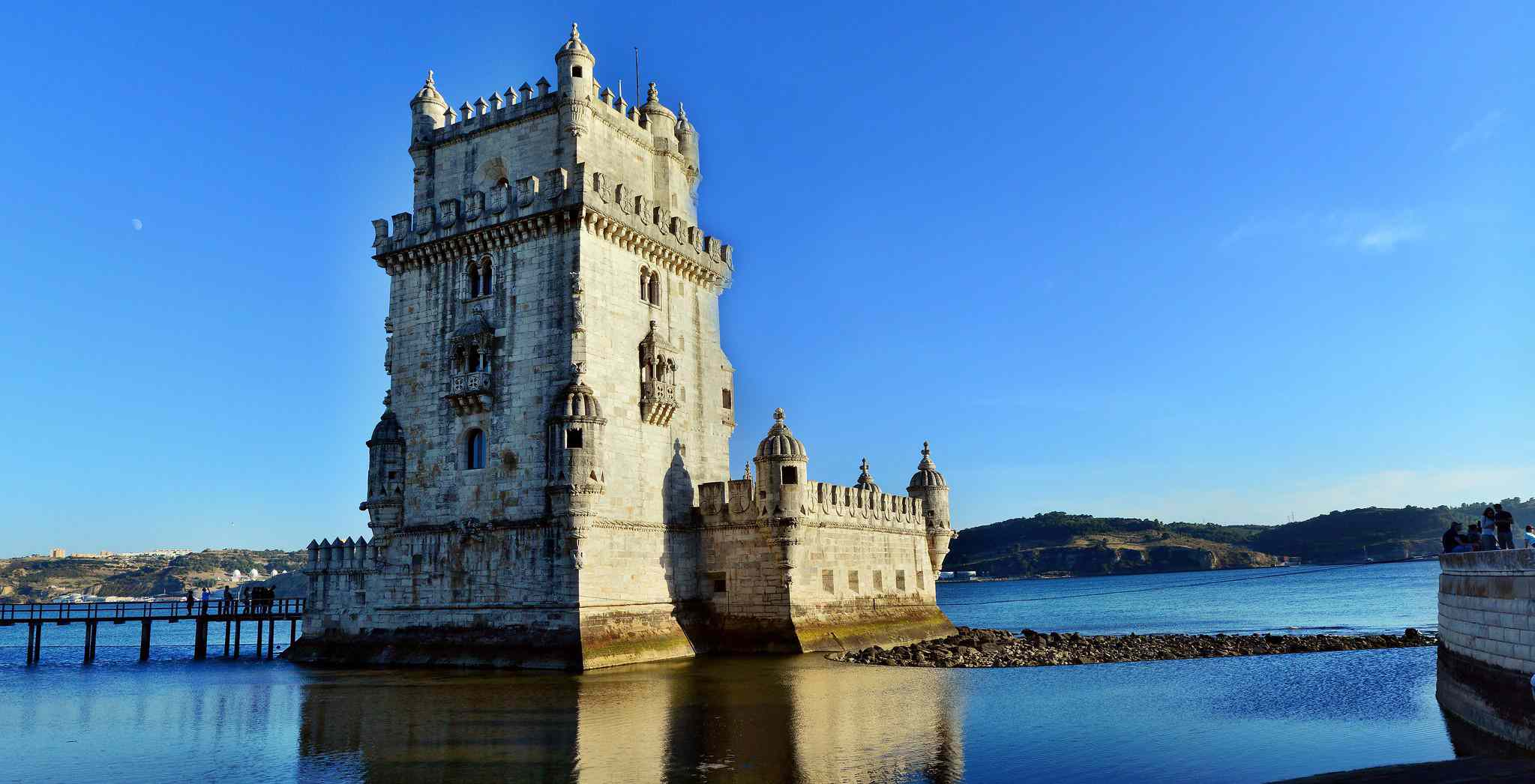Belem Tower, on the banks of the Tangus River, under a clear blue sky