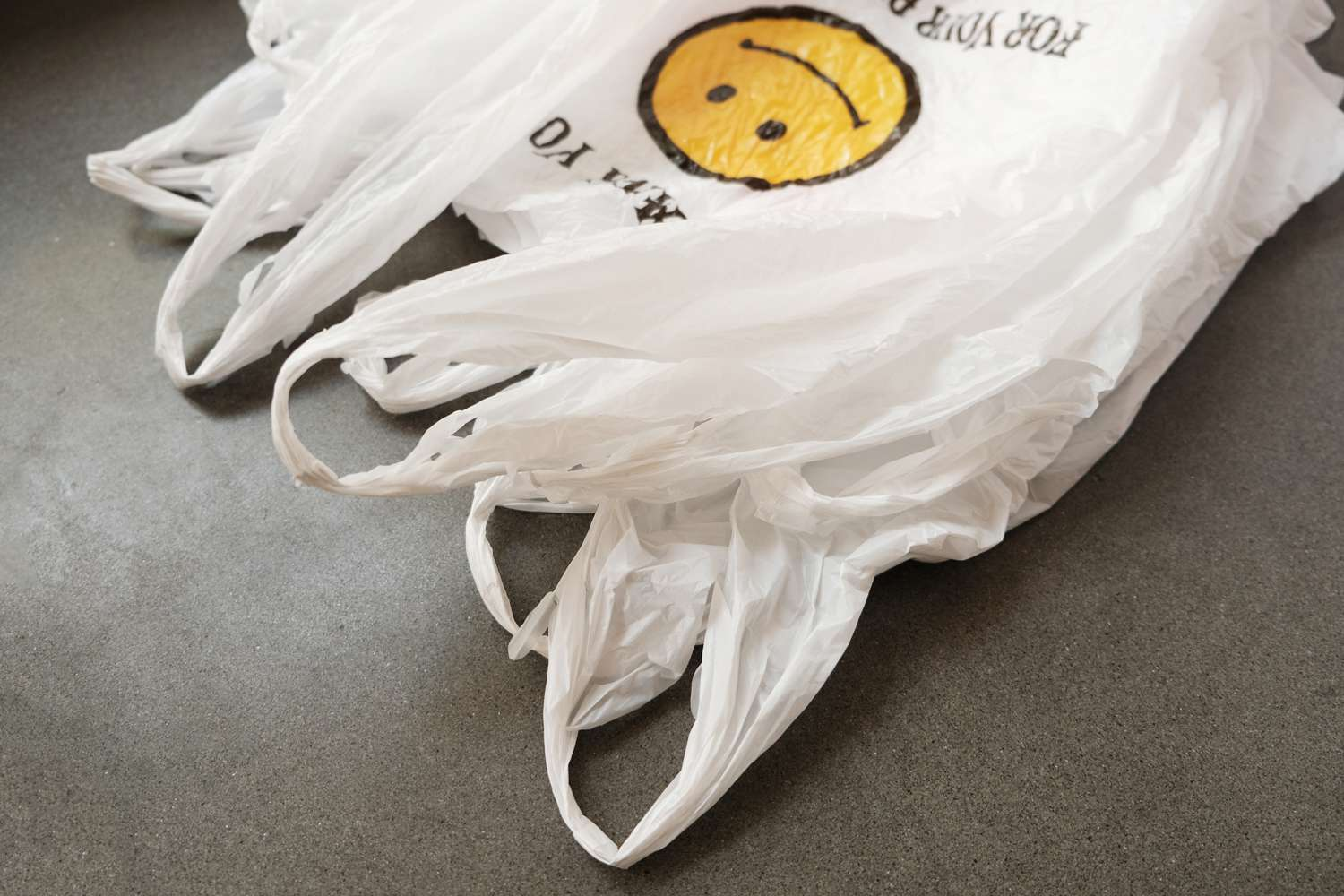 empty plastic bags on gray surface