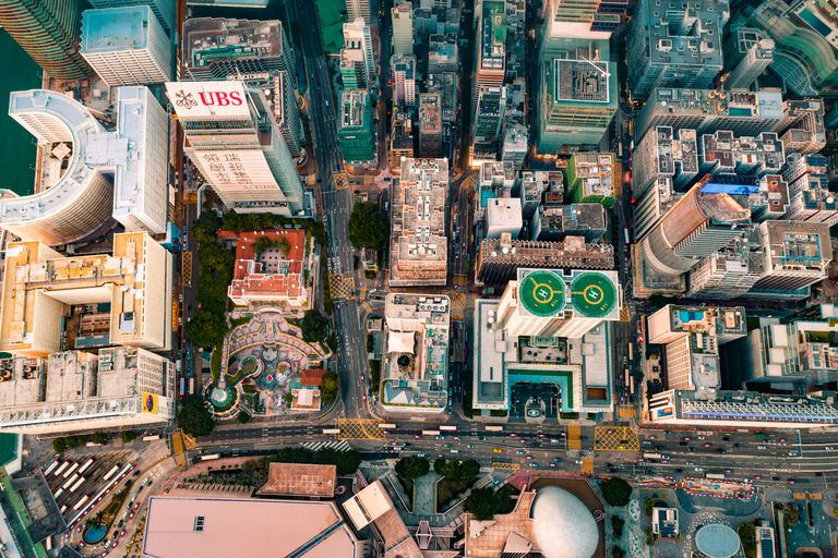 An aerial shot of buildings that are shaped like letters when seen from above.