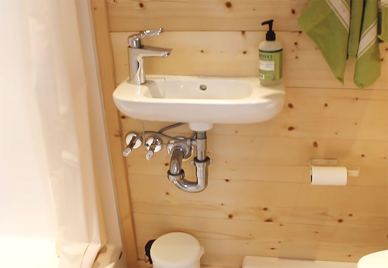 tiny house with houseplants bathroom sink