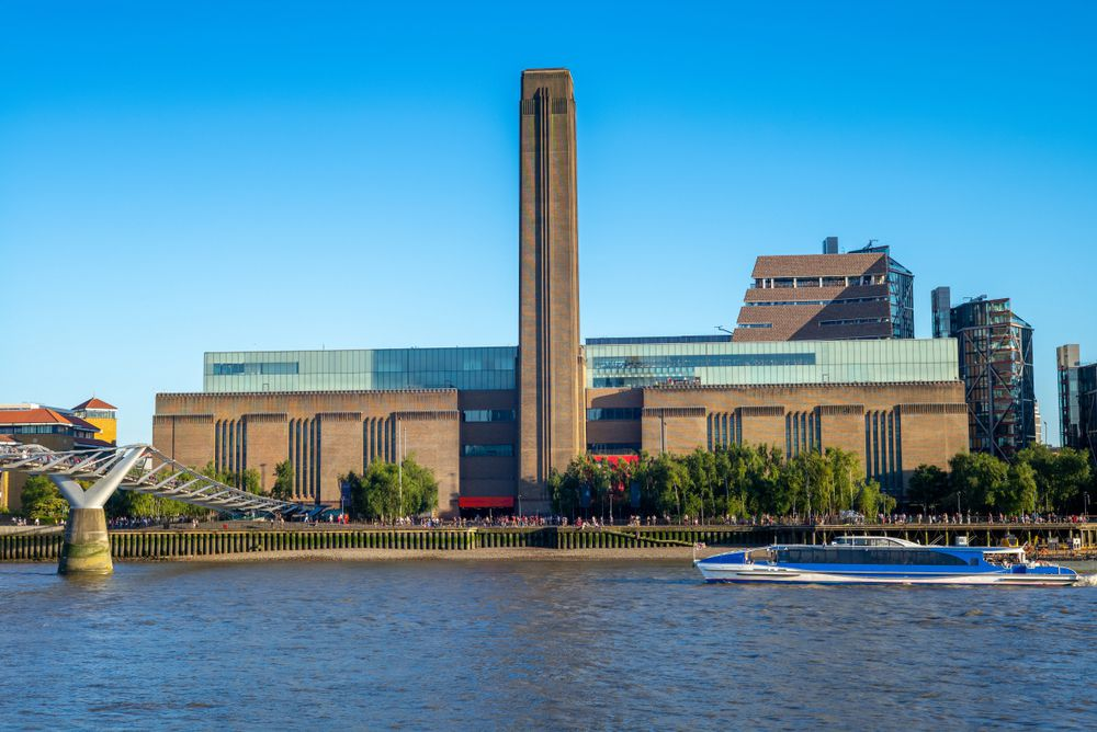 The renovated Tate Museum as viewed from the River Thames on a clear day in London