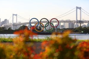 A general view of the Olympic rings installation and Rainbow Bridge as the sun sets on day twelve of the Tokyo 2020 Olympic Games at Odaiba Marine Park on August 04, 2021 in Tokyo, Japan.