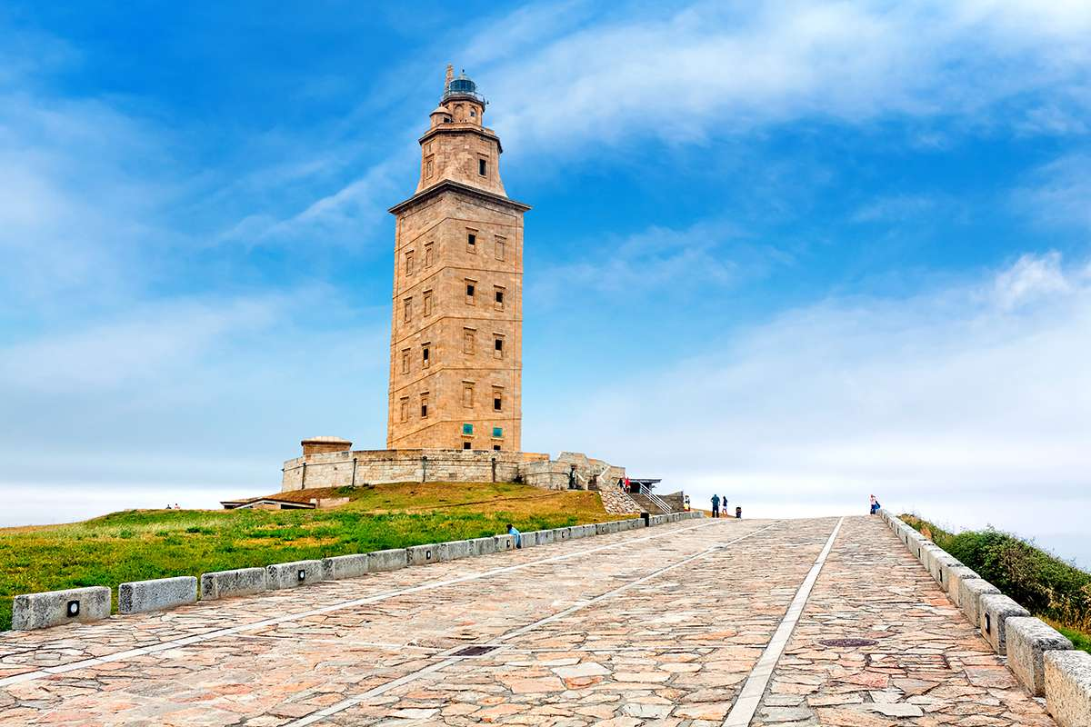 The Tower of Hercules rises above the harbor in Coruña, Spain