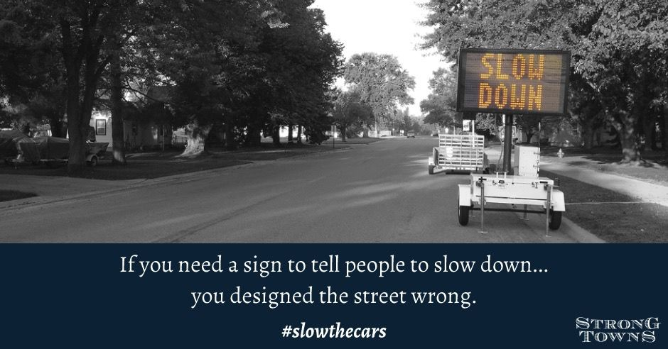 slow the cars sign