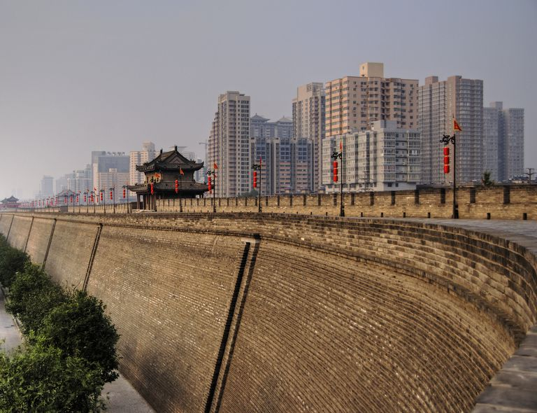 The ancient Xi'an City Wall stands before the city's modern skyline.