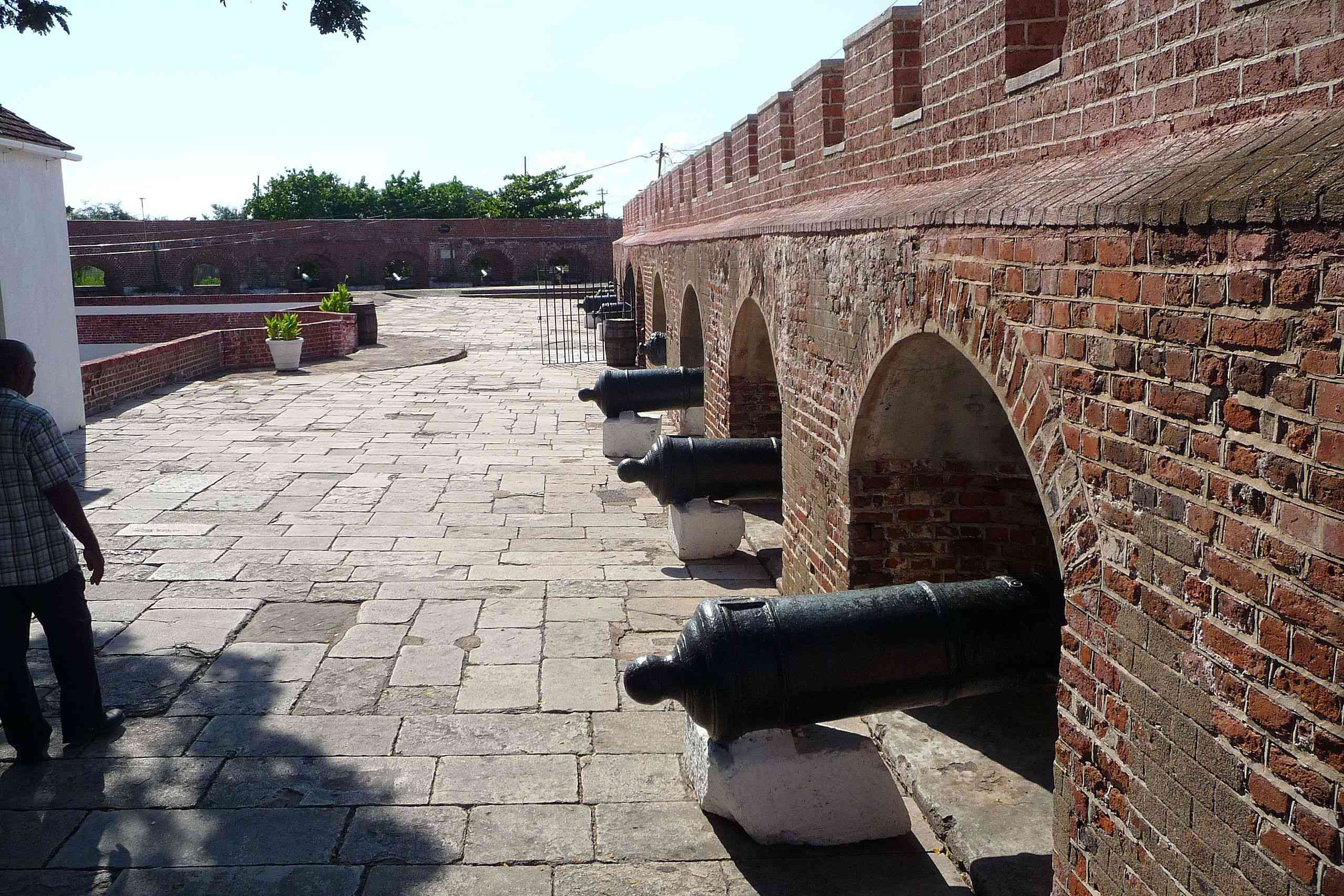 Cannons flanking the perimeter of a historic fortress