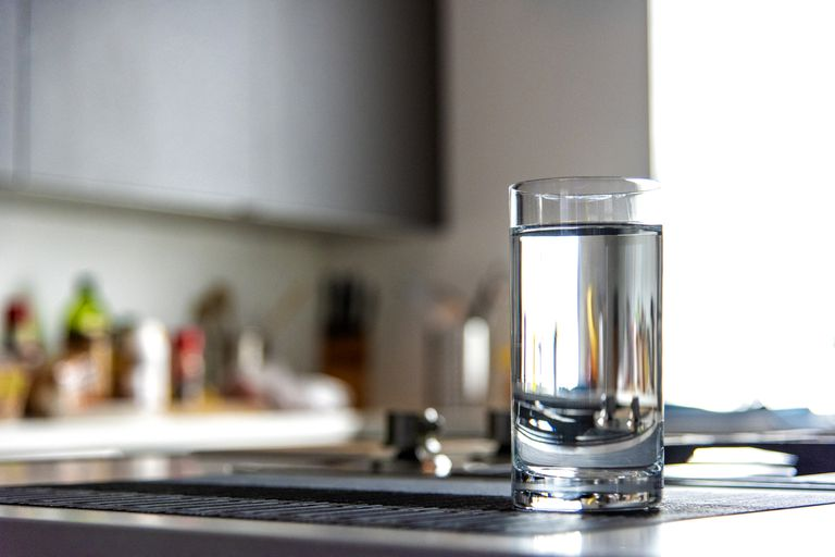 Glass of water on a kitchen counter