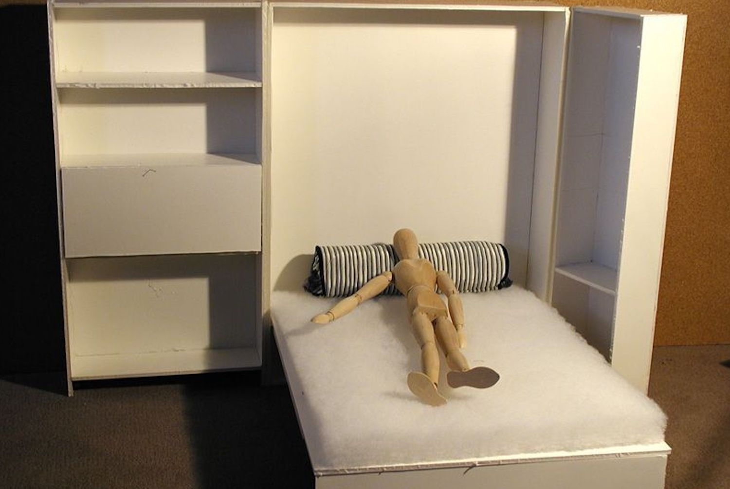 Model of bed folding out of armoire