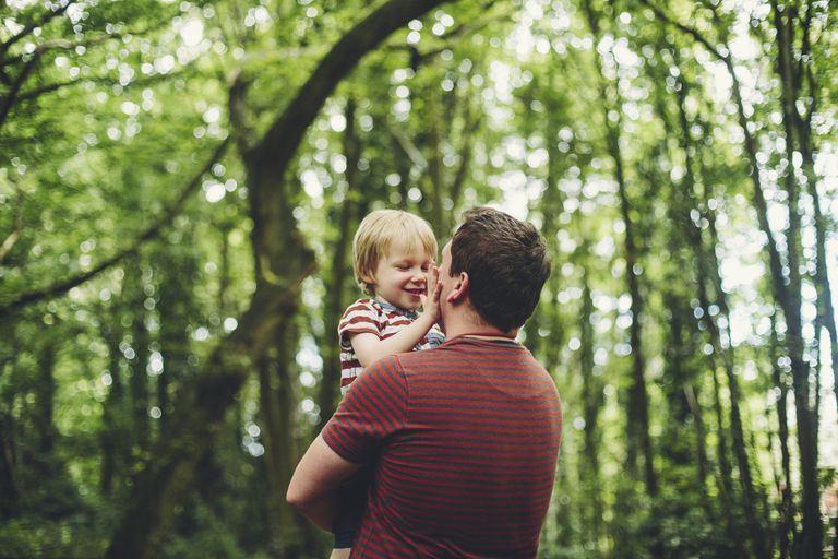Man with boy in the woods