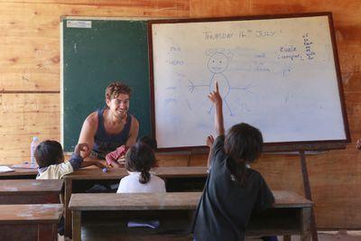 A volunteer teaches English in rural Cambodia
