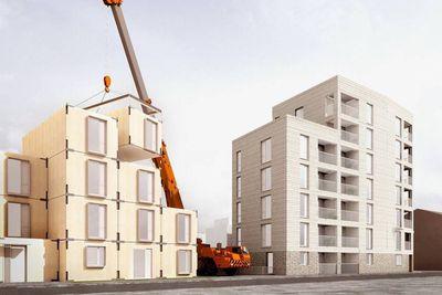 Rendering of a crane assembling modular buildings
