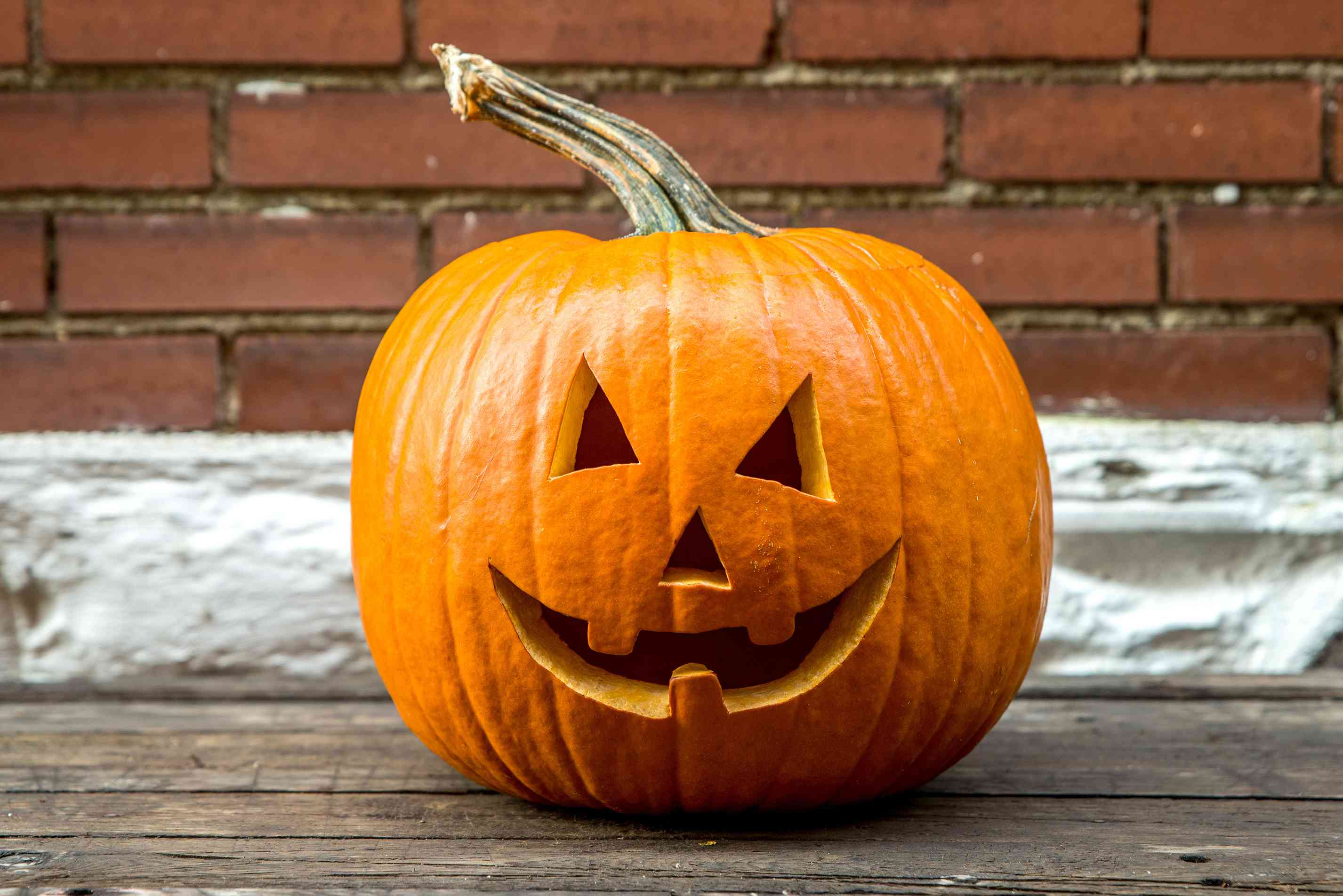 glossy carved pumpkin on outdoor table