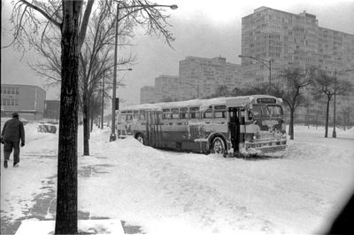 View of a Chicago Transit Authority (CTA) bus making a stop along its route during a winter blizzard in Chicago, IL, January 1967. Icicles hang from its carriage.