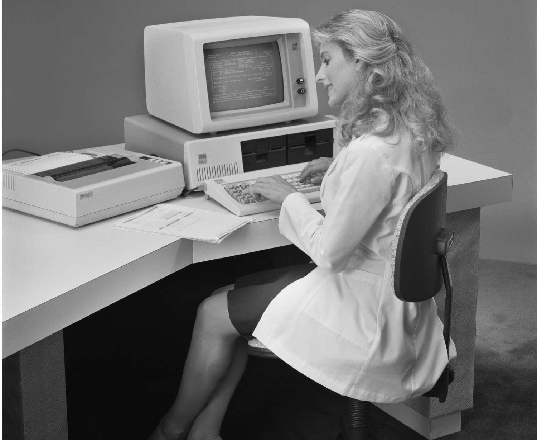 Woman at IBM PC