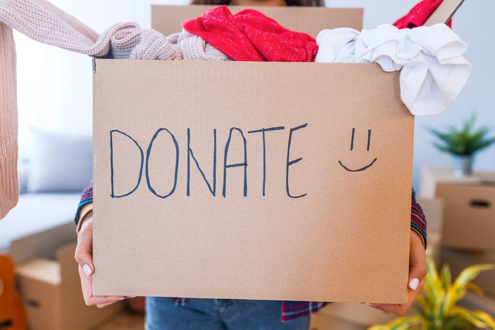 woman holding box marked donate