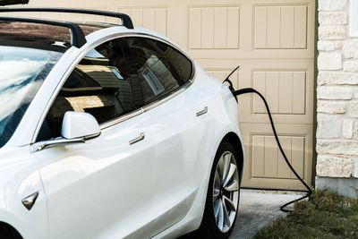A Tesla electric vehicle charging at home