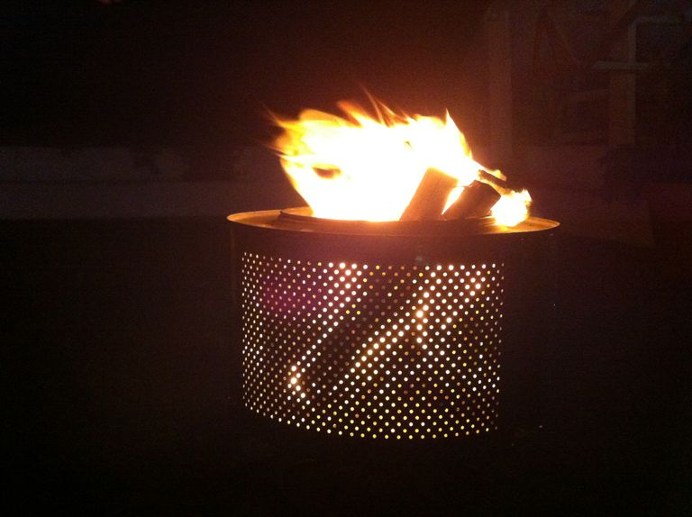 Fire pit made out of a broken washing machine
