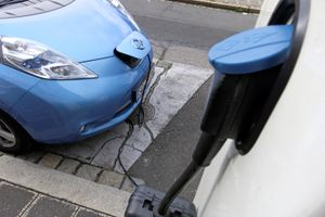 Blue car being charged