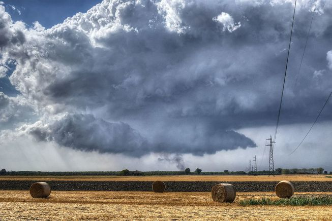 A wall cloud extends from a cumulonimbus cloud in in Sant'Agata Bolognese, Bologna, Italy