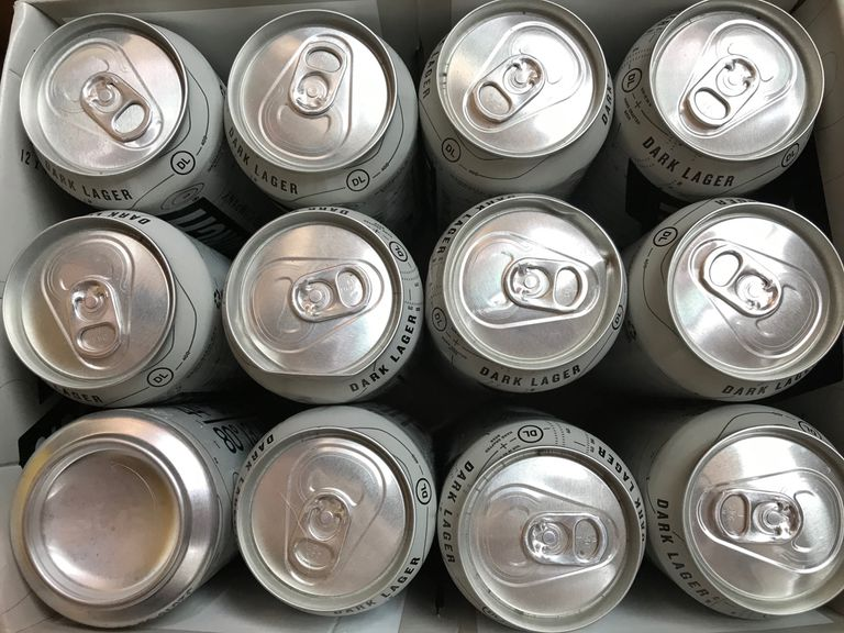 View from the top of a dozen silver beer cans