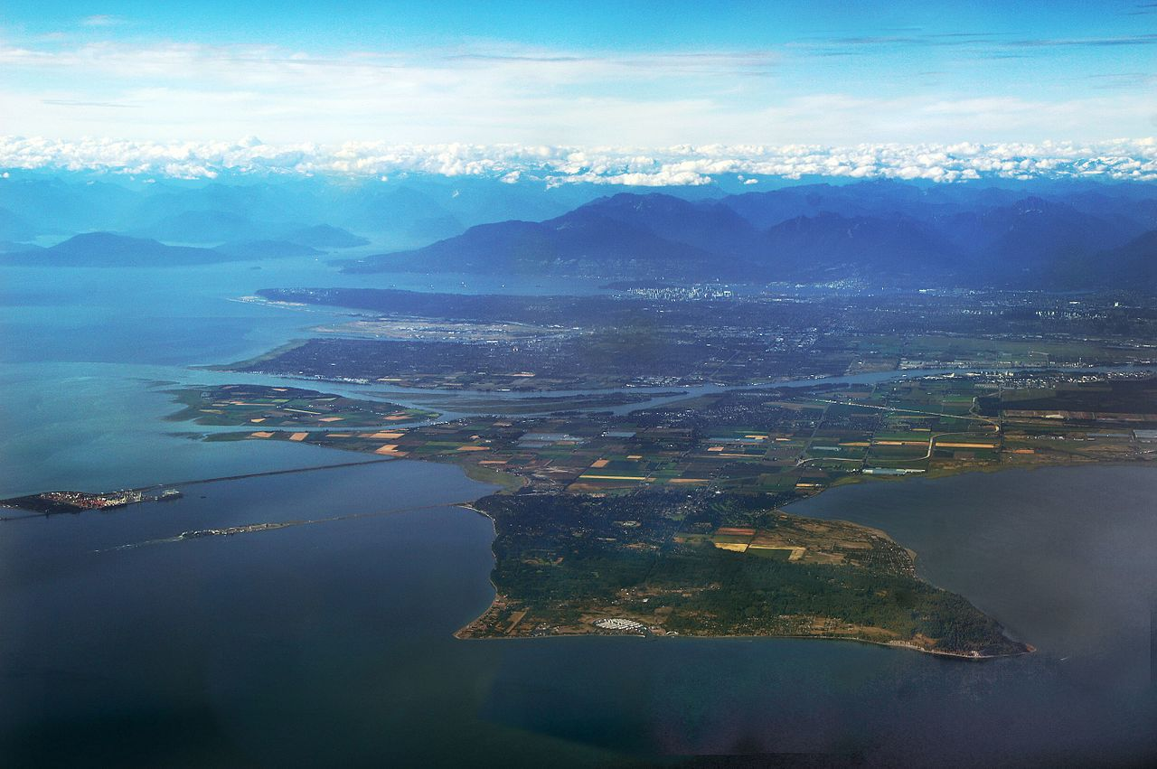 Aerial view of Point Roberts flanked by water and mountains