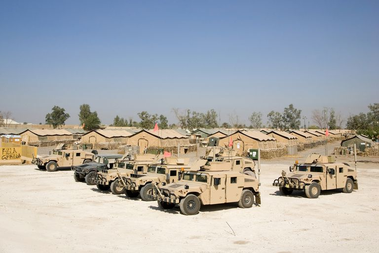 A lineup of humvees near camp ready to go out on a convoy