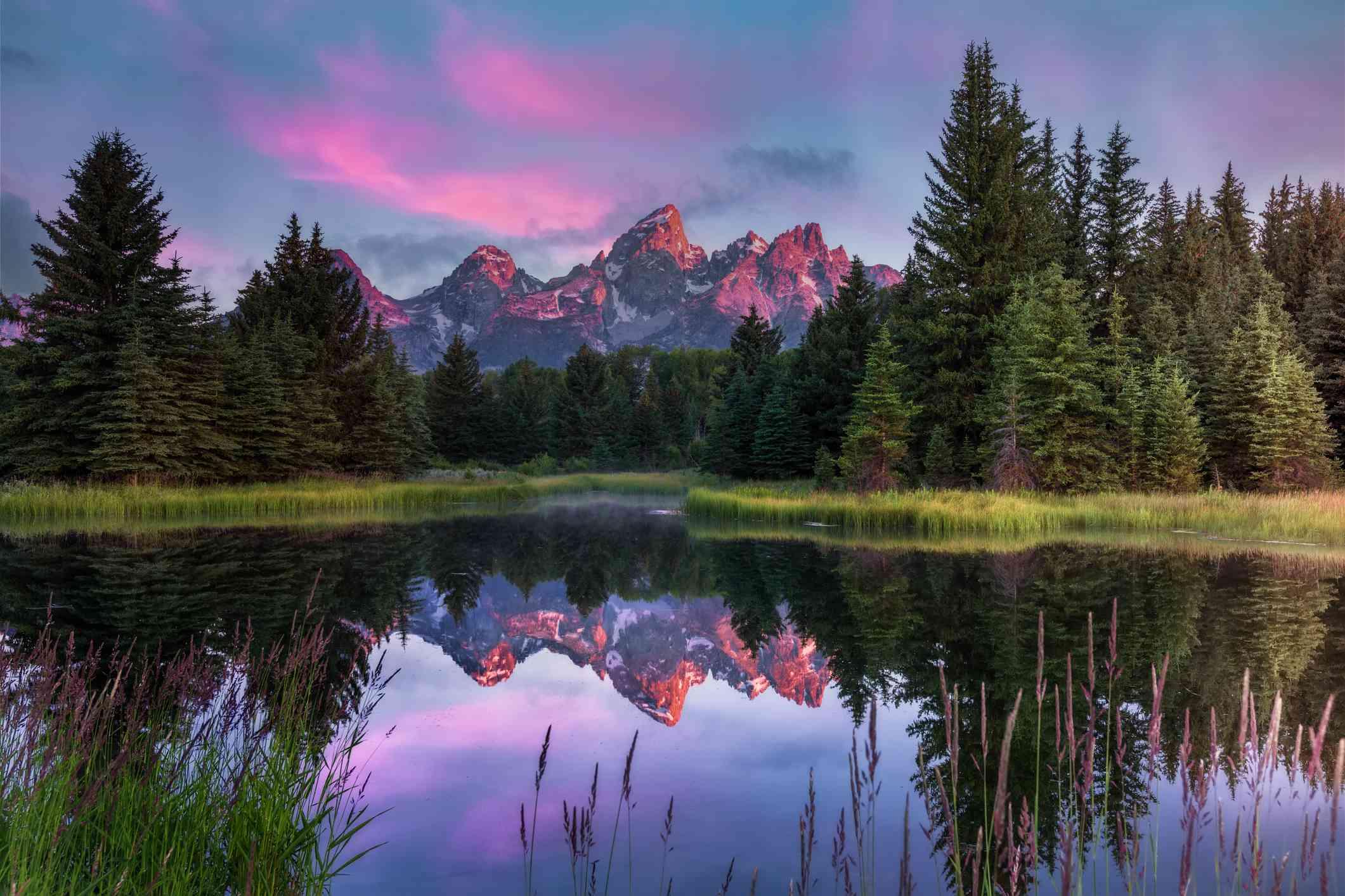 Sunrise over the Grand Teton Mountains and lake