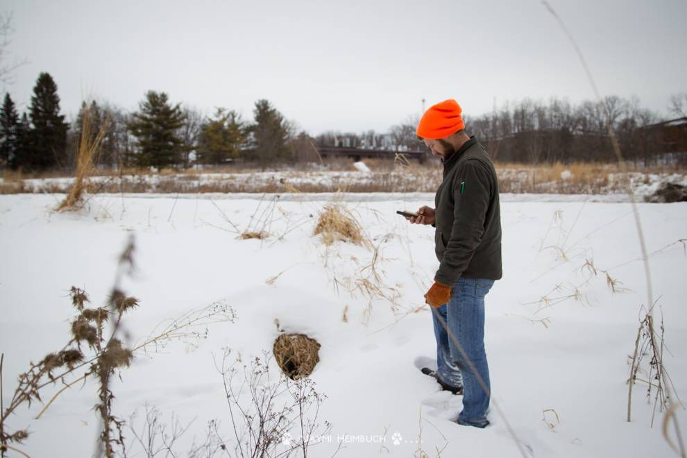 researcher noting GPS location