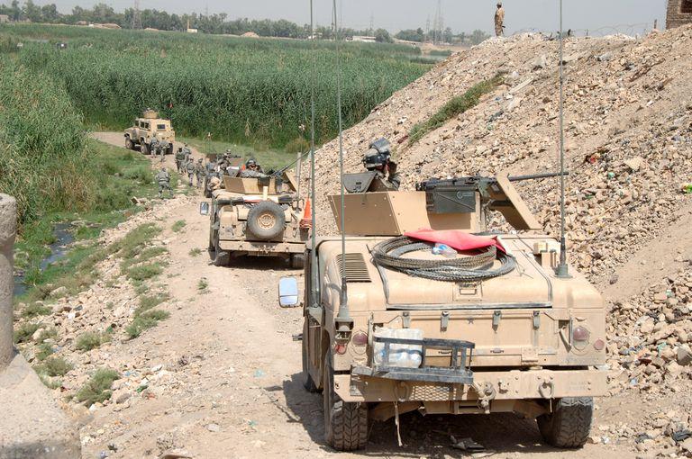U.S. and Iraqi Humvees on patrol in 2006