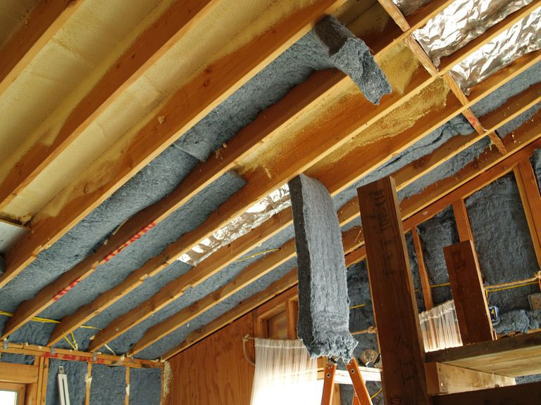 Recycled denim insulation being installed in a roof.