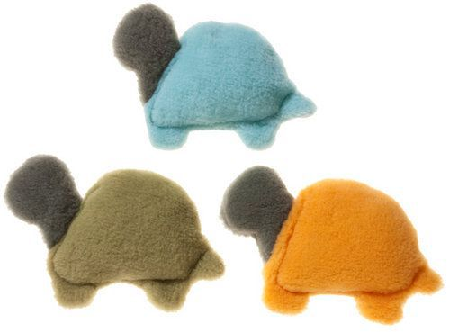 three colored turtle dog toys on a white background