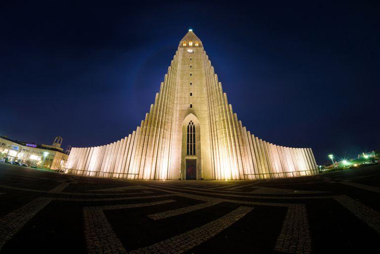 Illuminated building against a dark night sky