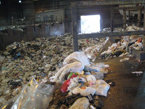 A room full of waste at a trash facility.