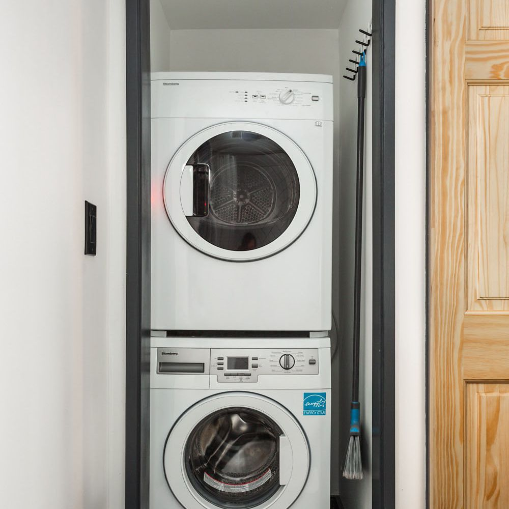 Stacked washer and dryer in the bathroom